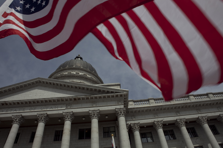 U.S. flag flying in front of the Utah State Capitol. Utah State Capitol image.